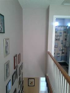 Tall, narrow wall above stairs