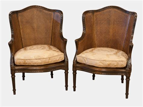 Pair Of French Carved Bergere Armchairs