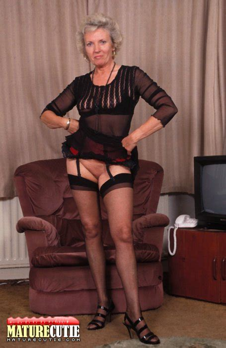 Stockings Wearing Milf Shows Her Shaved Pussy On Cam Porn Tv