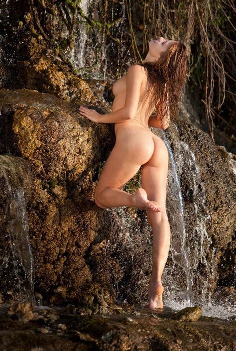 Skinny Russian Doll With Amazing Boobs Posing In Waterfall