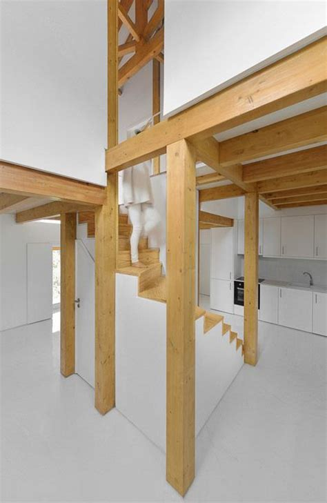 wooden trusses support  mezzanines   remodelled stone building staircases