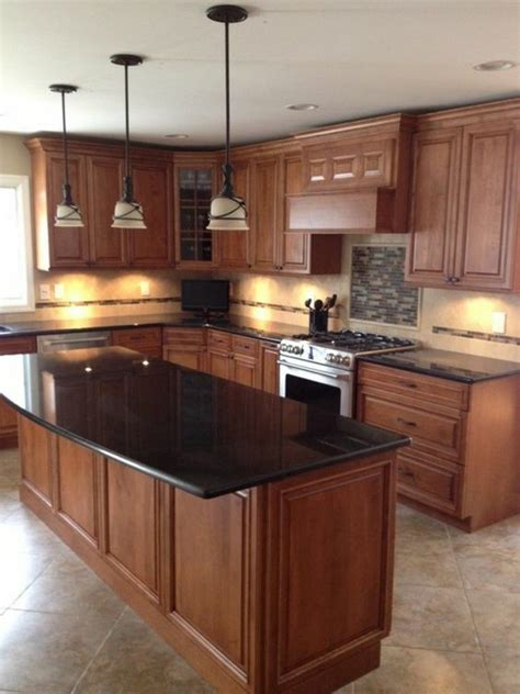 kitchen island with granite countertop black granite countertops in a wooden kitchen with