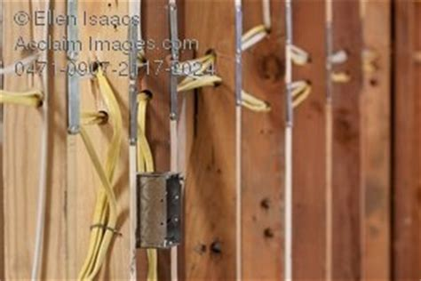 stock photography of electrical wires running through wall