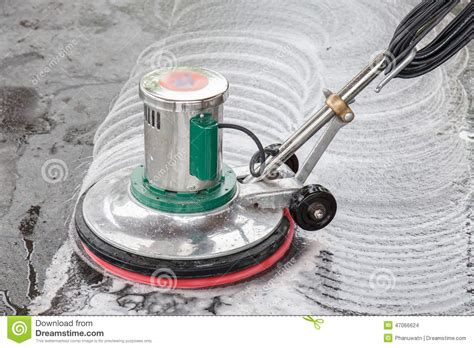 thai cleaning black granite floor with machine and