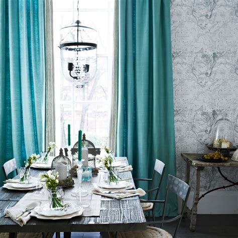grey tones dining room with turquoise curtains dining