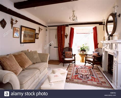 Patterned Rug And Beige Velour Sofa In Country Living Room