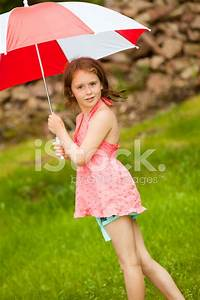 Little Girl With Umbrella IN The Sunny Day Stock Photos