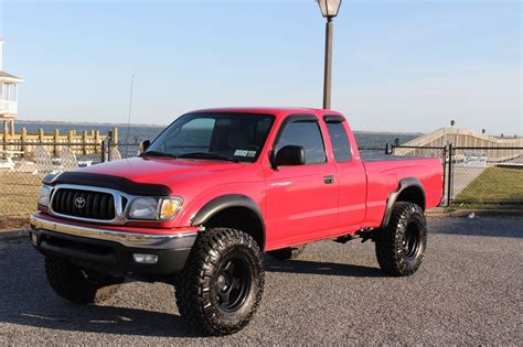 lots  extras  toyota tacoma sr lifted truck  sale