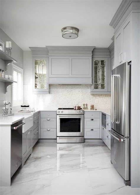 Kitchen floor tiles are not only used in our homes but are also used commercially in industries and here we see unique kitchen floor tiles in earthy colours that resemble natural stone and comprise. 15 Amazing Kitchen Flooring Designs   Design Listicle