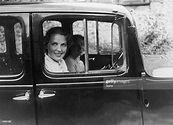 Diana Beaumont at the wheel of her car with fellow actress ...