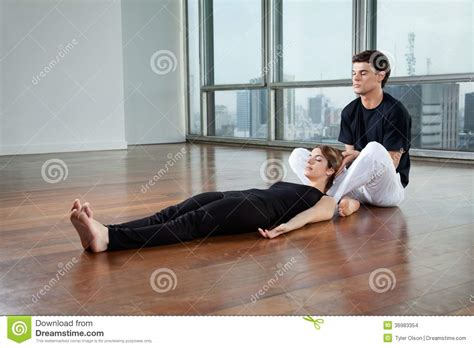 instructor helping woman  yoga exercise stock images