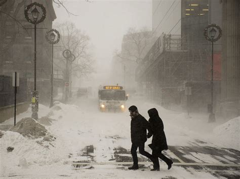 blizzard halifax canada canadian snow conditions heavy maritimes cold toronto blasts brave pedestrians unseasonably grip region jan friday weather whiteout