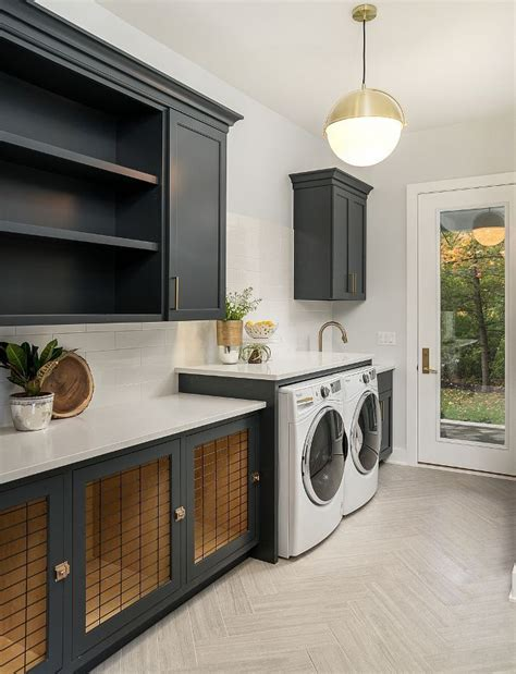 modern farmhouse laundry room with charcoal black cabinets