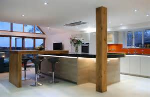 grey kitchen island handleless grey quartz worktops and solid oak detail uckfield