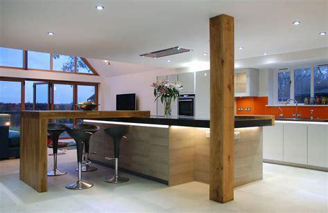 L Shaped Kitchen Islands - handleless grey quartz worktops and solid oak detail uckfield