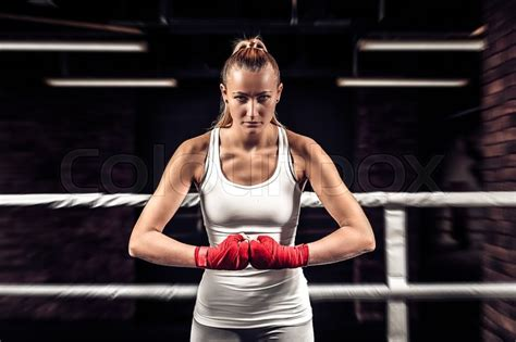 Young Athlete Girl Boxer Showing Her Fists With Bandage