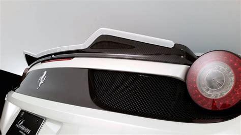 Adaptive frontlight system, door armrest in alcantara, red brake calipers, cruise control, colored safety belts, leather central tunnel, daytona style seats. Rowan Ferrari Italia 458 rear spoiler