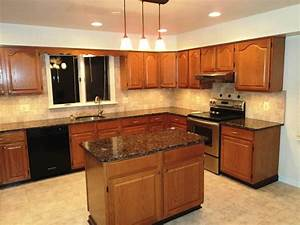 Oak cabinets with dark brown countertop google search for Kitchen cabinets lowes with golden gate wall art