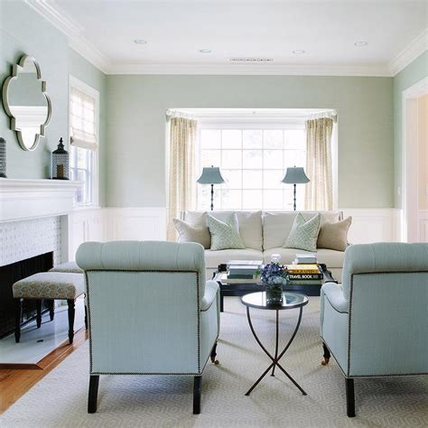 white and blue living room with blue roll back chairs
