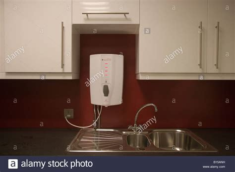 An electric water heater above a sink. This kitchen is in