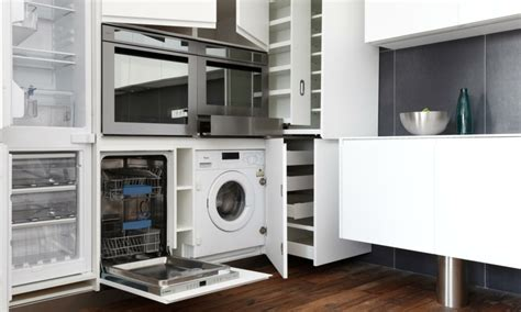 machine a laver dans la cuisine meuble machine à laver pour un coin buanderie pratique