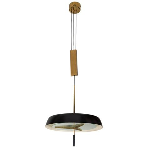 pendant light with brass pulley by stilnovo for sale at