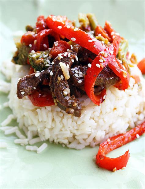 Return beef to skillet with tomato halves and dressing; Ginger Beef Stir Fry - The Comfort of Cooking
