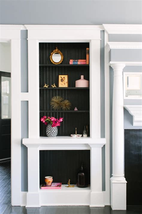 White And Black Bookcase by Black And White Bookcase With Black Wood Paneling Hgtv