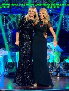 Ladies in black! Tess Daly smoulders in elegant floor ...
