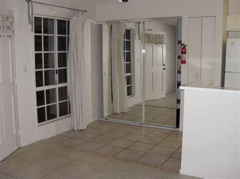 bifold closet doors lowes bifold mirrored closet doors home design ideas