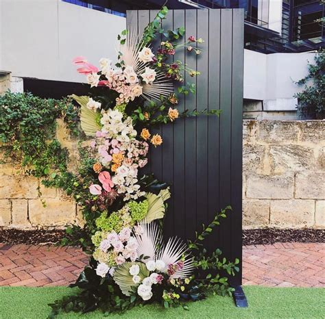 Glorious flowers and foliage on a wall panel for a wedding