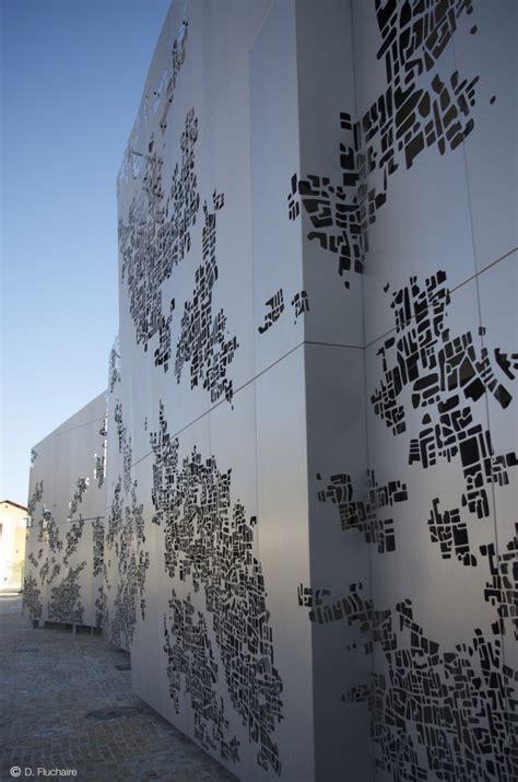 cr 233 ation de la maison des associations des chutes lavie par atelier naom nouveaux architectes