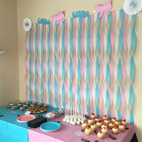 gender reveal table ideas mustache and bows dessert table streamer wall gender