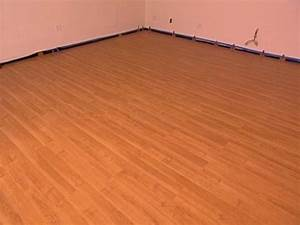 How to install snap together laminate flooring hgtv for How to lay down laminate flooring