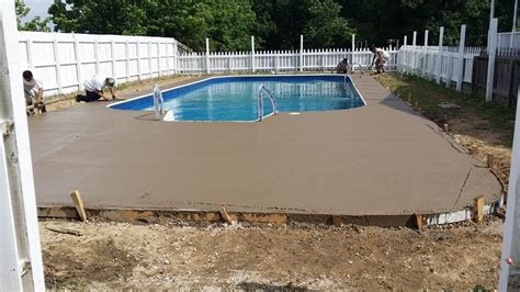 concrete sting around pool with slide installation a