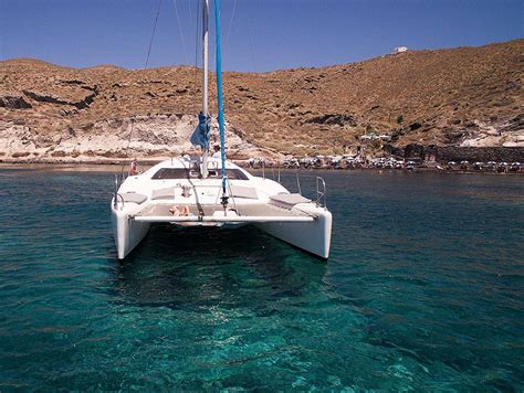 Catamaran Sailing In Santorini by Yacht Charter Catamaran Santocruise Santorini Island Greece