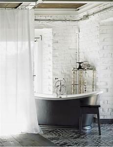 Exposed brick walls eclectic bathroom elle decor