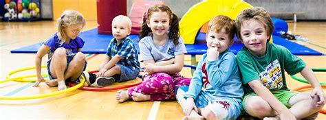 preschool ymca of northern alberta 739 | children sitting in gym CH02