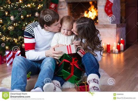 Happy Parents Kissing Little Son And Giving Gifts Stock
