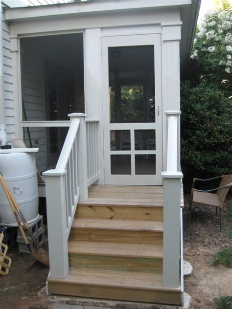 screen porch w wood handrails on the steps s