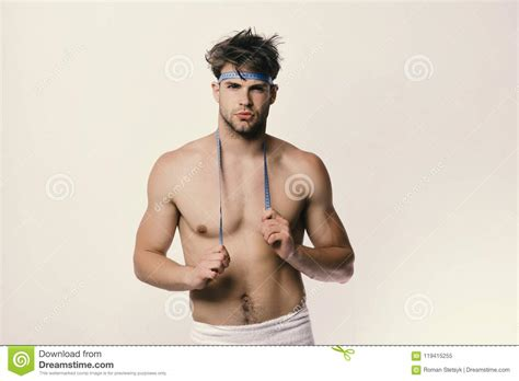 Guy With Towel And Flexible Ruler Isolated On White Background Man With Confident Face And