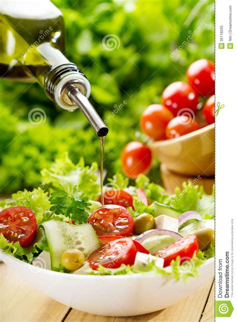 olive oil pouring  salad royalty  stock photo