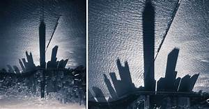 The shadowy skyline of chicago towers over lake michigan for The shadowy skyline of chicago towers over lake michigan