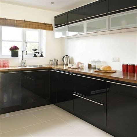 gloss black kitchen cabinets blossy black cabinets with timber benchtops again i think 3845