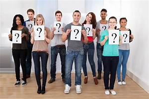 College Students Holding Question Mark Signs Stock Photo ...