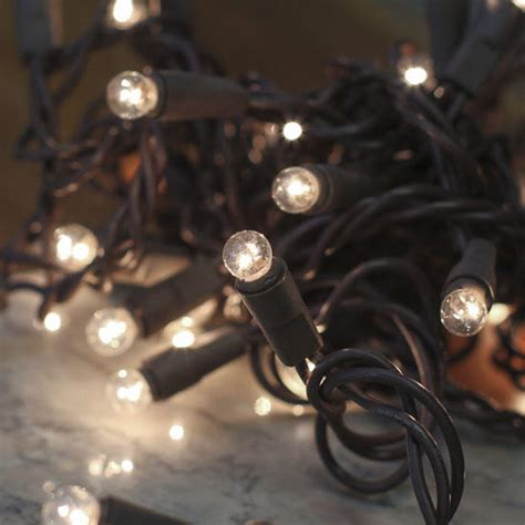 clear globe bulb and brown cord string lights lighting