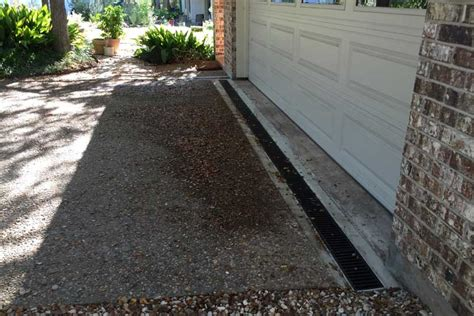 driveway runoff solutions drainage and stormwater management contractor austin tx