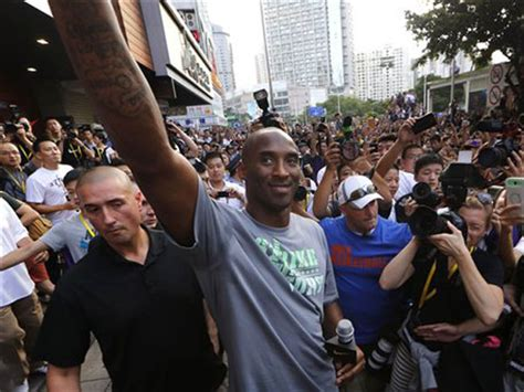 kobe bryant braves bad weather hits manila anew