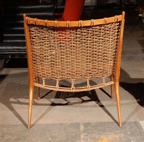 teak and woven leather lounge chairs image 10