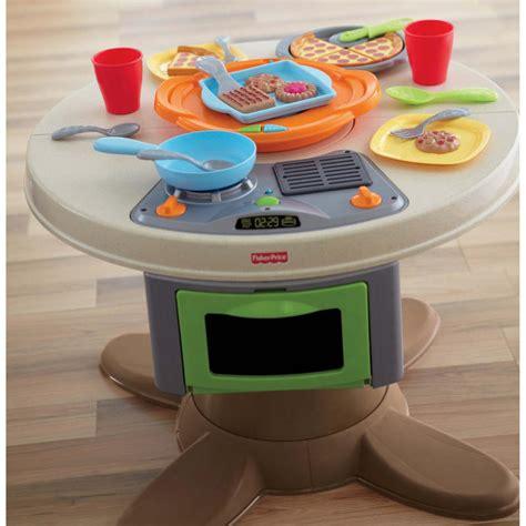 fisher price kitchen childrens fisher price servin suprises 2 in 1 kitchen table